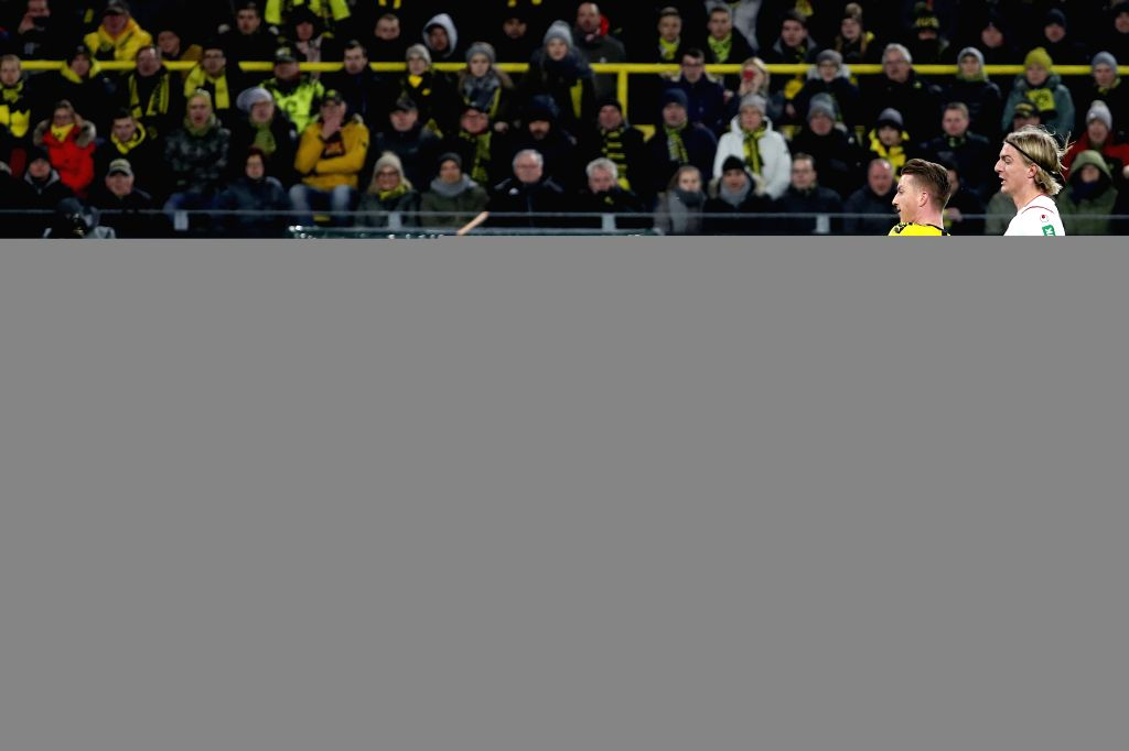 Marco Reus (2nd, R) of Dortmund shoots the ball during a German Bundesliga match between Borussia Dortmund and FC Cologne in Dortmund, Germany, Jan. 24, 2020.