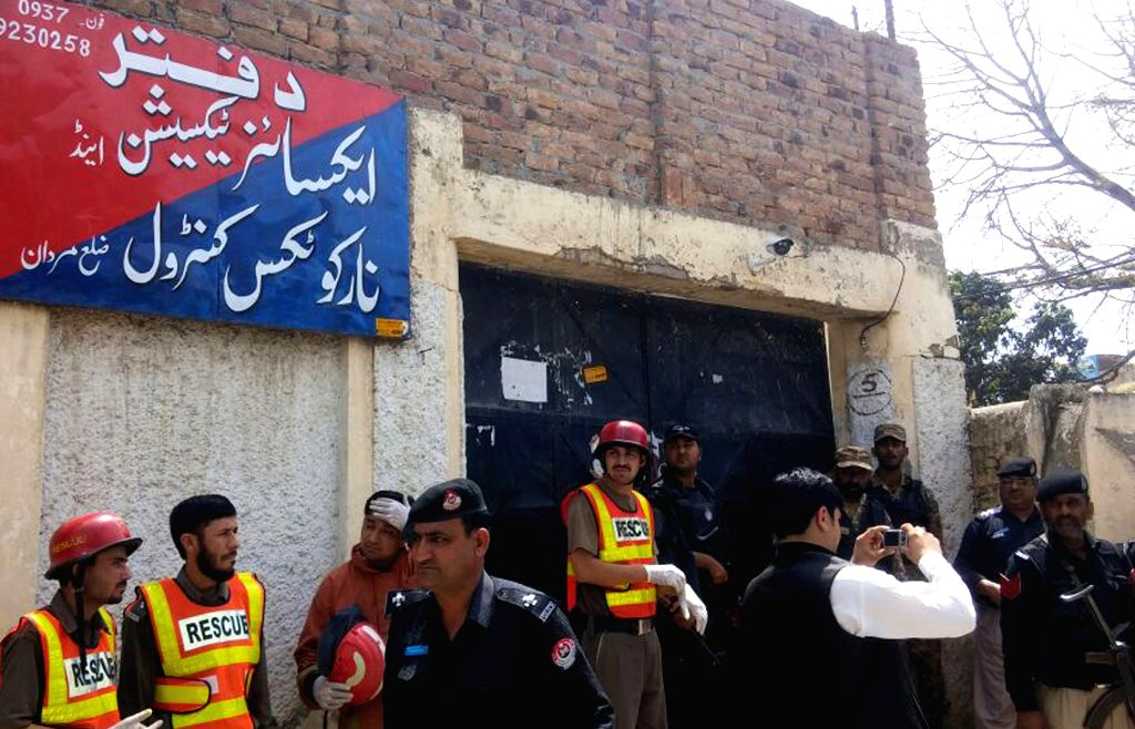 MARDAN, April 19, 2016 - Policemen and rescuers gather at the blast site in northwest Pakistan's Mardan, on April 19, 2016. At least 22 people were injured when a suicide blast hit a government ...