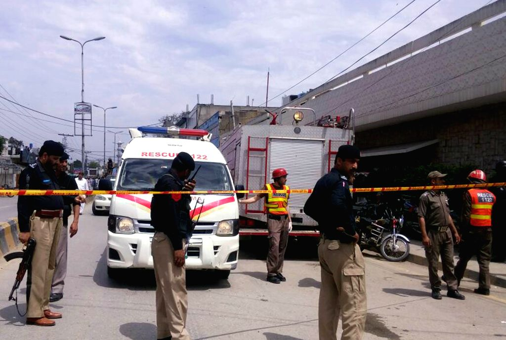 MARDAN, April 19, 2016 - Policemen cordon off the suicide blast site in northwest Pakistan's Mardan, on April 19, 2016. At least 22 people were injured when a suicide blast hit a government office in ...