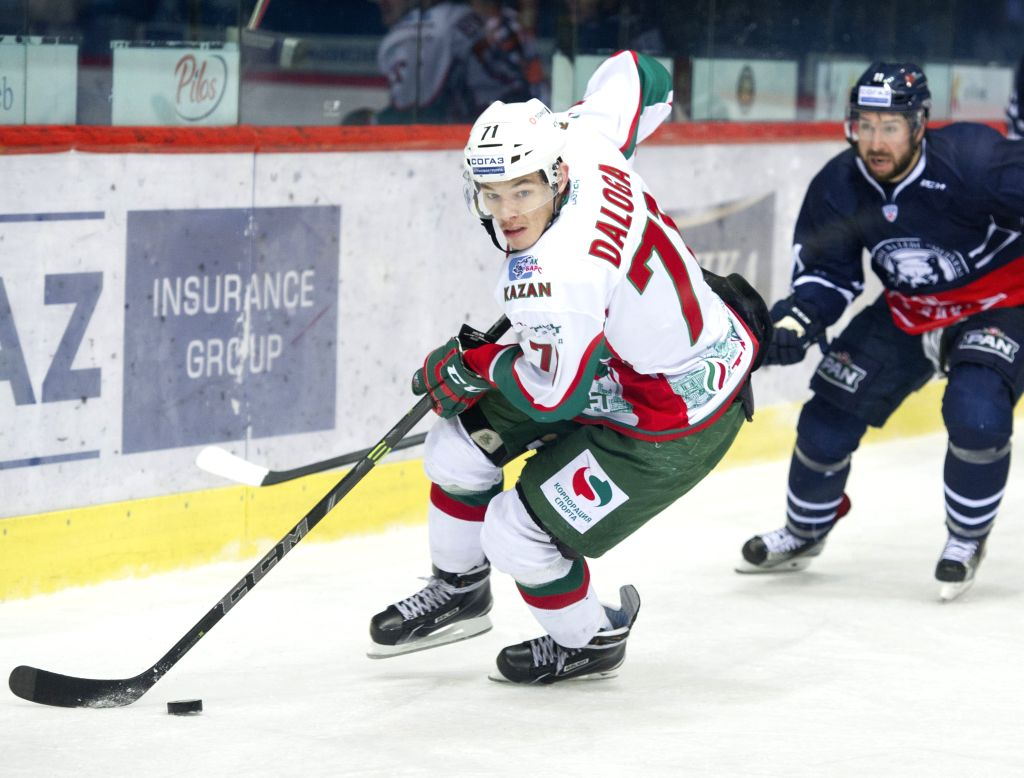 Marek Daloga of Ak Bars Kazan (L) drives the puck during Kontinental Hockey League (KHL) match against Medvescak Zagreb in Zagreb, capital of Croatia, Oct. 28, 2015. ...