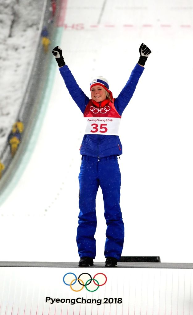 Maren Lundby of Norway celebrates on a podium after winning the gold medal in the women's normal hill individual ski jumping competition of the PyeongChang Winter Olympics at Alpensia ...