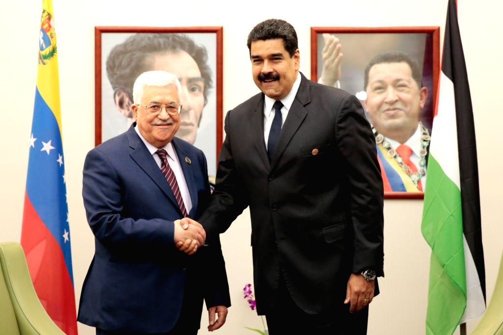 MARGARITA, Sept. 17, 2016 - Venezuela's President Nicolas Maduro (R) meets with Palestinian President Mahmoud Abbas during the 17th Non-Aligned Movement (NAM) Summit in Margarita Island, Venezuela, ...