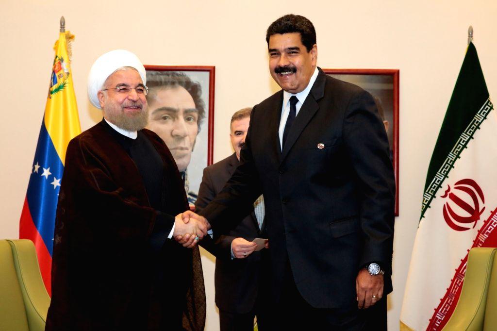 MARGARITA, Sept. 17, 2016 - Venezuela's President Nicolas Maduro (R) meets with Iran's President Hassan Rouhani during the 17th Non-Aligned Movement (NAM) Summit, in Margarita Island, Venezuela, on ... - Hassan Rouhani