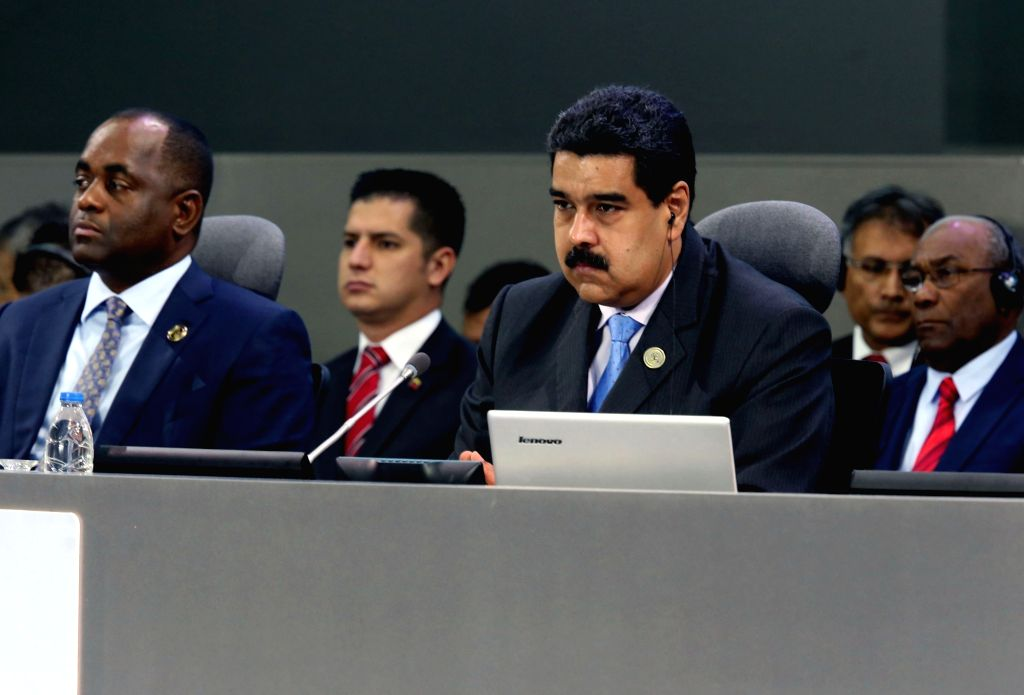 MARGARITA, Sept. 19, 2016 - Venezuelan President Nicolas Maduro (R) takes part in the High-Level Plenary Meeting of the 17th Summit of the Non-Aligned Movement (NAM) in Margarita Island of Venezuela, ...