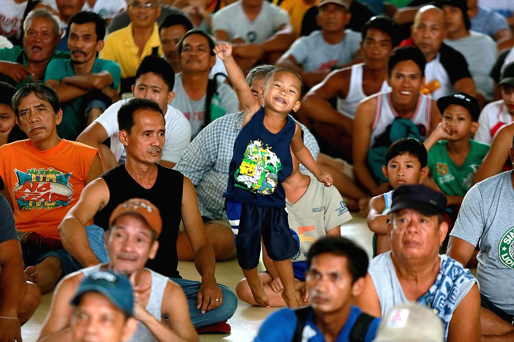 MARIKINA CITY, July 15, 2018 - People watch a live broadcast of the boxing match between Lucas Matthysse of Argentina and Manny Pacquiao of the Philippines inside a gymnasium in Marikina City, the ...