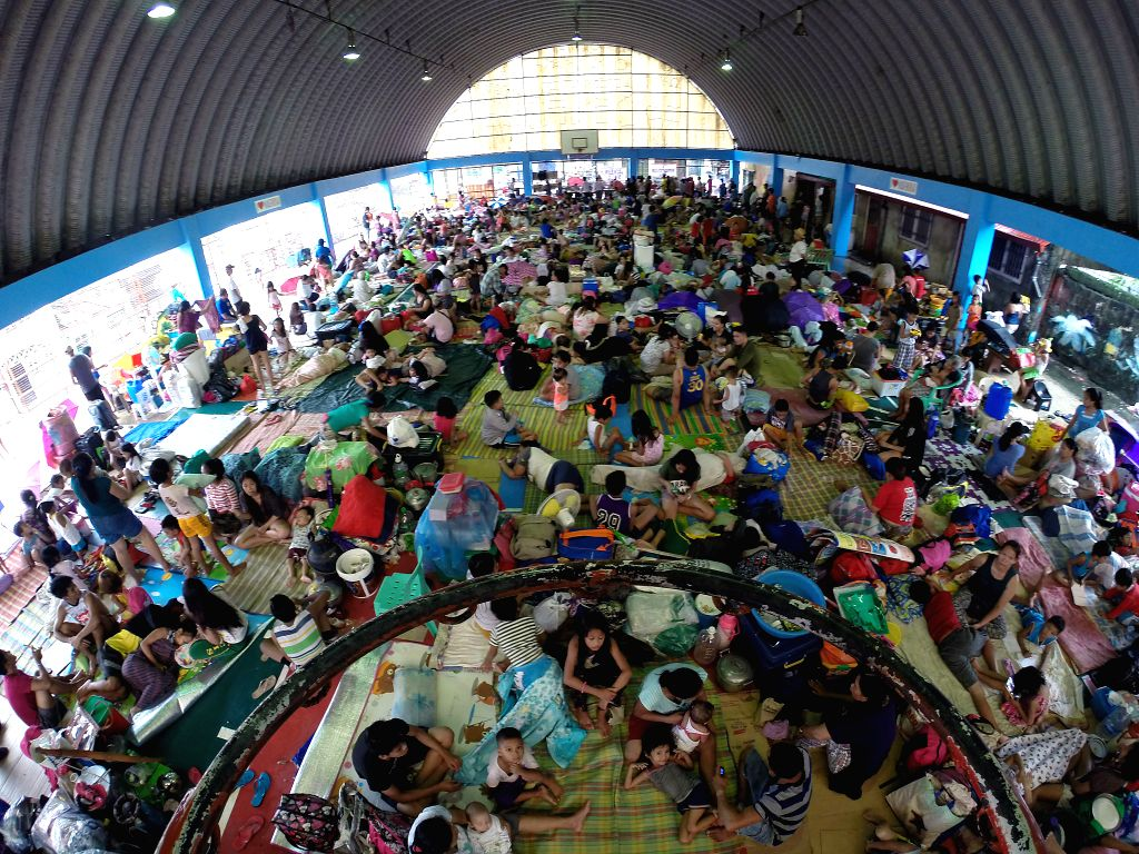 MARIKINA CITY, July 22, 2018 - Residents rest at an evacuation center in Marikina City, the Philippines, July 22, 2018. At least five people died and more than 700,000 were affected by days of heavy ...