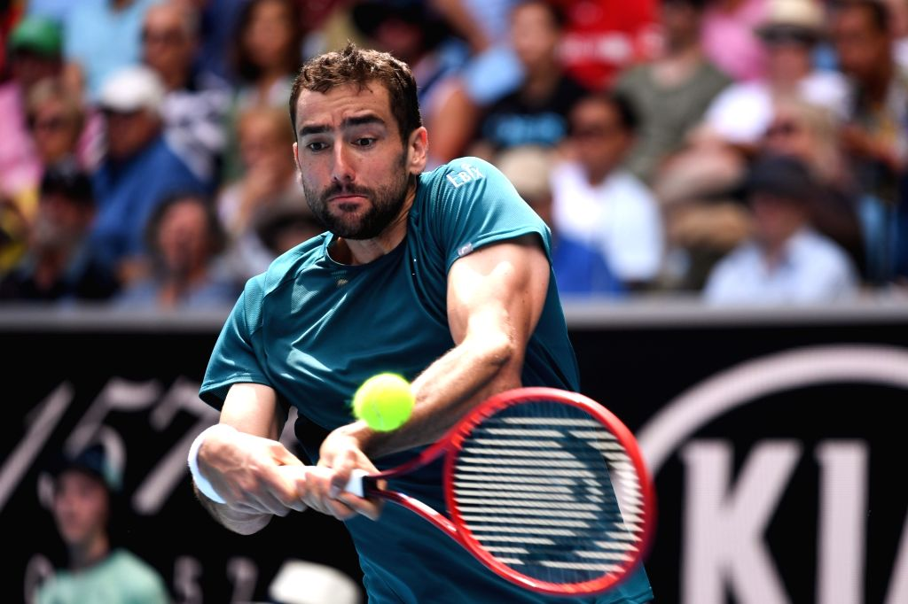 Marin Cilic of Croatia hits a return during the men's singles 4th round match against Milos Raonic of Canada at the Australian Open tennis championship in ...