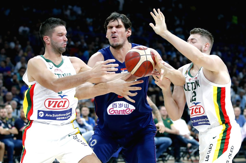 Marjanovic (C) vies with Lithuania's Martinas Geben (R) and Mantas Kalnietis during a friendly basketball match between Serbia and Lithuania in Belgrade, Serbia on Aug. 10, 2019.