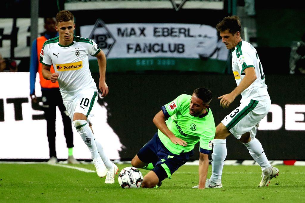 Mark Uth (C) of FC Schalke 04 competes during the Bundesliga match between Borussia Monchengladbach and FC Schalke 04 at the Borussia-Park, in ...