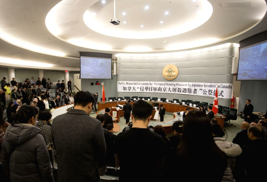 MARKHAM (CANADA), Dec. 13, 2018 People attend a memorial ceremony on the second Ontario's Nanjing Massacre Commemorative Day at Markham Civic Center in Markham, Ontario, Canada, on Dec. ...