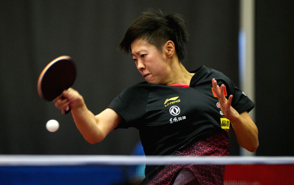 MARKHAM, Dec. 7, 2019 - Liu Xi of China returns the ball to Honoka Hashimoto of Japan during the first round of women's singles match at the 2019 ITTF Chanllenge Plus North American Open in Markham, ...