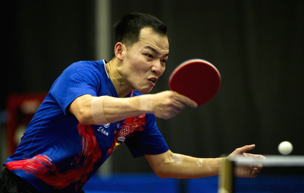 MARKHAM, Dec. 7, 2019 - Ren Hao of China returns the ball to Brian Afanador of Puerto Rico during the first round of men's singles match at the 2019 ITTF Chanllenge Plus North American Open in ...