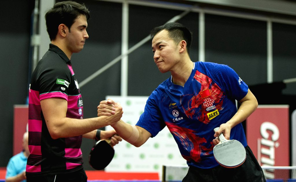 MARKHAM, Dec. 7, 2019 - Ren Hao (R) of China shakes hands with Brian Afanador of Puerto Rico after their first round of men's singles match at the 2019 ITTF Chanllenge Plus North American Open in ...