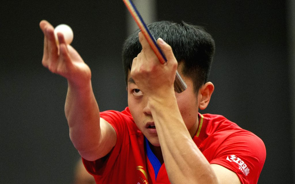 MARKHAM, Dec. 7, 2019 - Yuan Licen of China serves to Emmanuel Lebesson of France during the first round of men's singles match at the 2019 ITTF Chanllenge Plus North American Open in Markham, ...