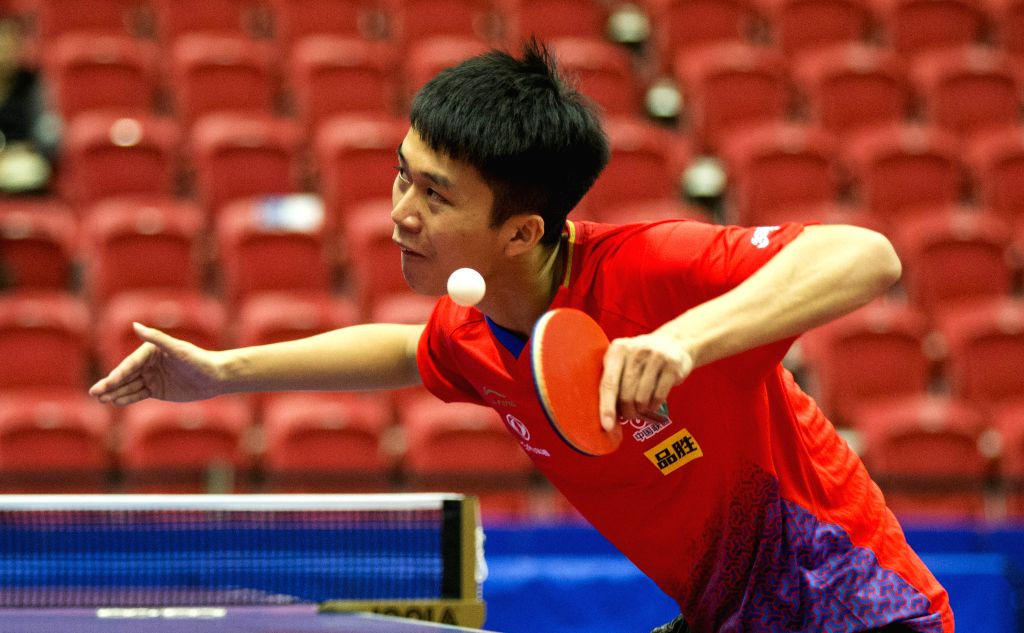MARKHAM, Dec. 7, 2019 - Zhao Zhaoyan of China serves to Horacio Cifuentes of Argentina during the first round of men's singles match at the 2019 ITTF Chanllenge Plus North American Open in Markham, ...