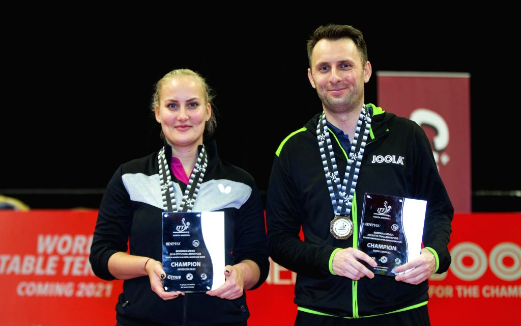 MARKHAM, Dec. 8, 2019 - Lubomir Pistej (R)/Barbora Balazova of Slovakia pose for photo during the awarding ceremony of the mixed doubles final match between Zhao Zhaoyan/Liu Xi of China and Lubomir ...
