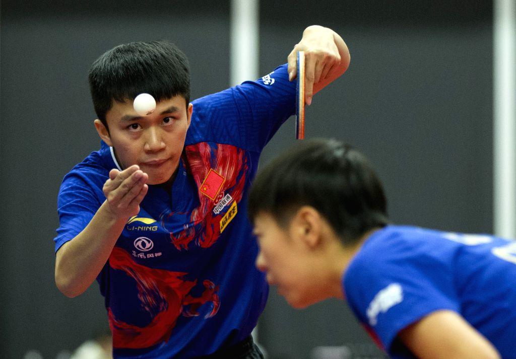 MARKHAM, Dec. 8, 2019 - Zhao Zhaoyan (L)/Liu Xi of China compete during the mixed doubles final match against Lubomir Pistej/Barbora Balazova of Slovakia at the 2019 ITTF Chanllenge Plus North ...