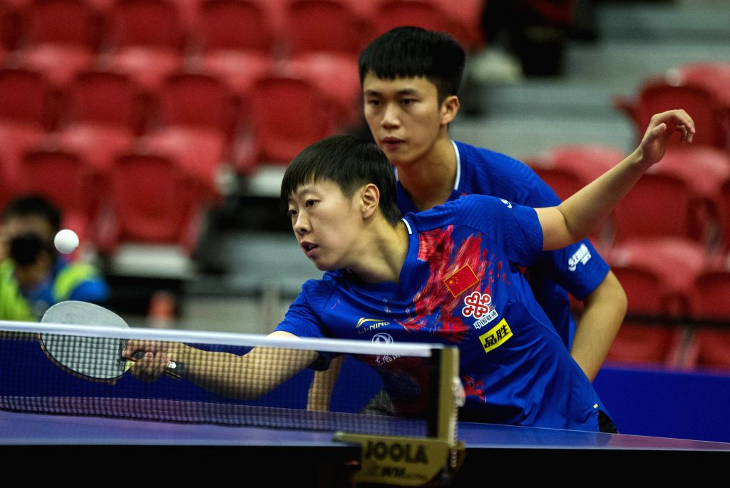 MARKHAM, Dec. 8, 2019 - Zhao Zhaoyan/Liu Xi (Front) of China compete during the mixed doubles final match against Lubomir Pistej/Barbora Balazova of Slovakia at the 2019 ITTF Chanllenge Plus North ...