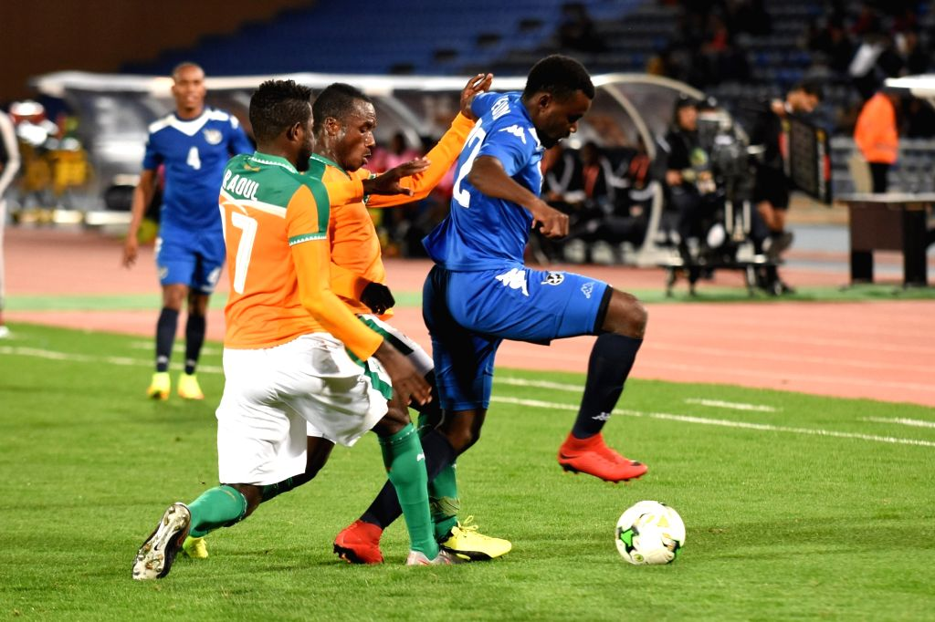 MARRAKECH, Jan. 15, 2018 - Haleluya Nekundi (R) of Namibia vies with Raoul Konan (C) of Cote d'Ivoire during their group B match in the African Nations Championship in Marrakech, Morocco, Jan. 14, ...