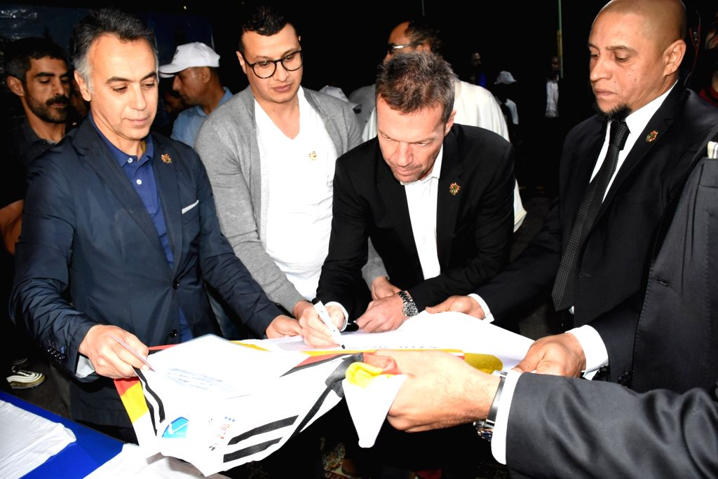 MARRAKECH, June 5, 2018 - Former German football player Lothar Matthaeus (R2) signs on a T-shirt at a caritative dinner at an orphan asylum in Marrakech, Morocco, June 4, 2018. Lothar Matthaeusx and ...