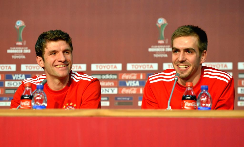 Bayern Munich's Thomas Muller (L) and Philipp Lahm attend a press conference in Marrakesh, Morocco, Dec. 20, 2013. Germany's Bayern Munich will ...