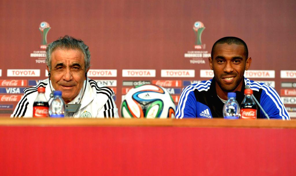 Coach Faouzi Benzarti (L) and striker Mouhssine Iajour of Morocco's Raja Casablanca attend a news conference in Marrakesh, Morocco, Dec. 20, 2013. ...