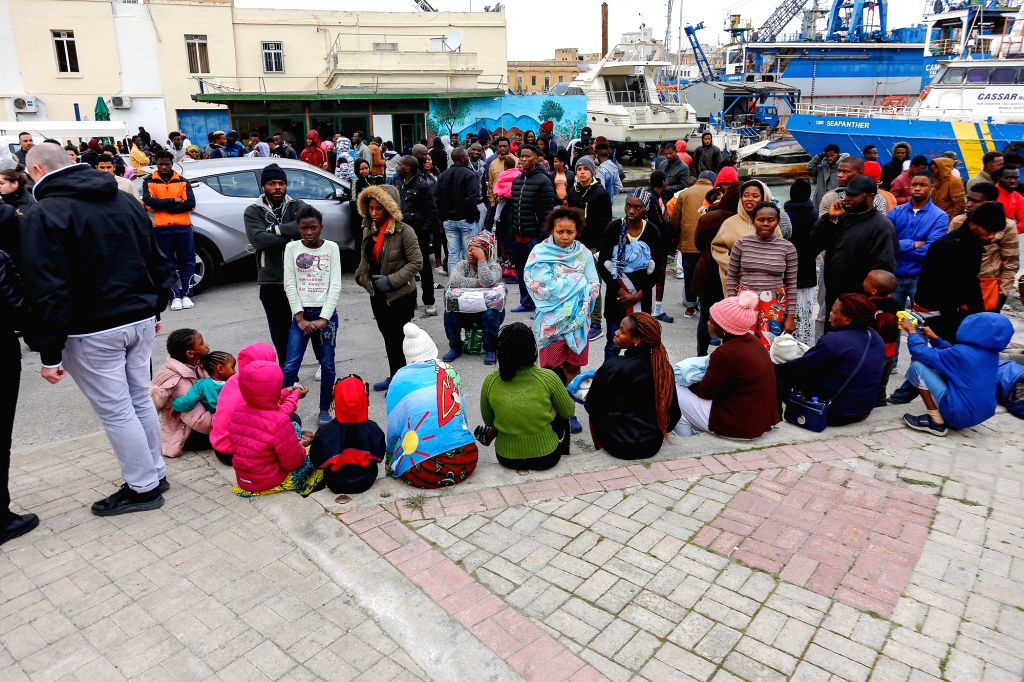 MARSA (MALTA), Jan. 8, 2020 Migrants wait outside a migrants reception center in Marsa, Malta, Jan. 8, 2020. Close to 500 migrants who are being detained in a reception center in Malta ...