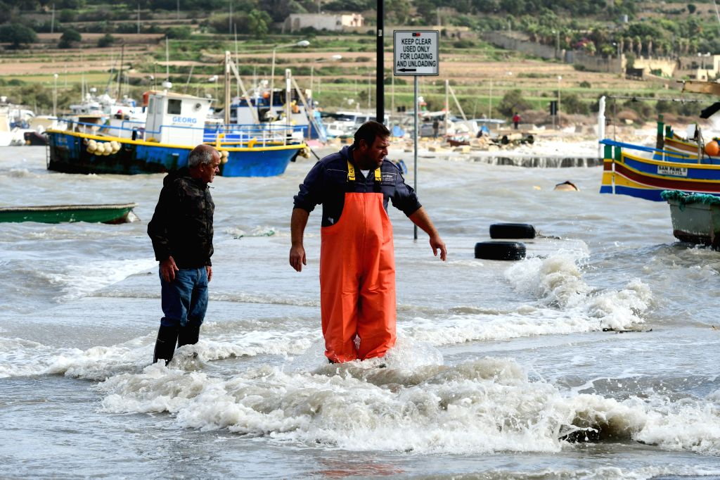 MARSAXLOKK (MALTA), Nov. 12, 2019 Fishermen make preparations for the gale-force winds in Marsaxlokk, Malta, Nov. 12, 2019. Malta suffered gale-force winds on Tuesday.