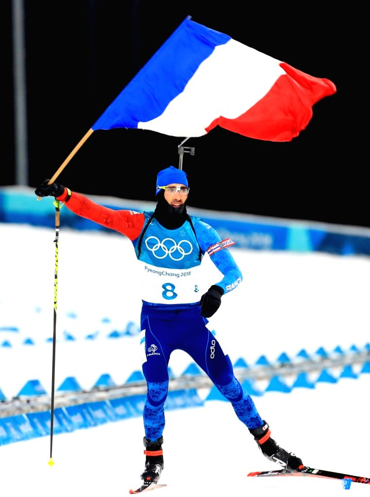 Martin Fourcade of France celebrates after winning the gold in the 12.5km men's biathlon pursuit finals at the PyeongChang Winter Olympics at Alpensia Biathlon Centre in Pyeongchang, 182 ...