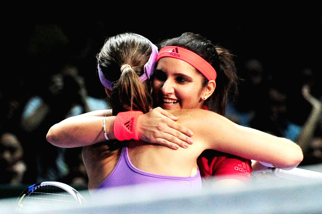Martina Hingis (front) of Switzerland hugs Sania Mirza of India after the women's doubles semi-final match against Chan Hao-Ching and Chan Yung-Jan of Chinese ... - Martina Hingis and Sania Mirza