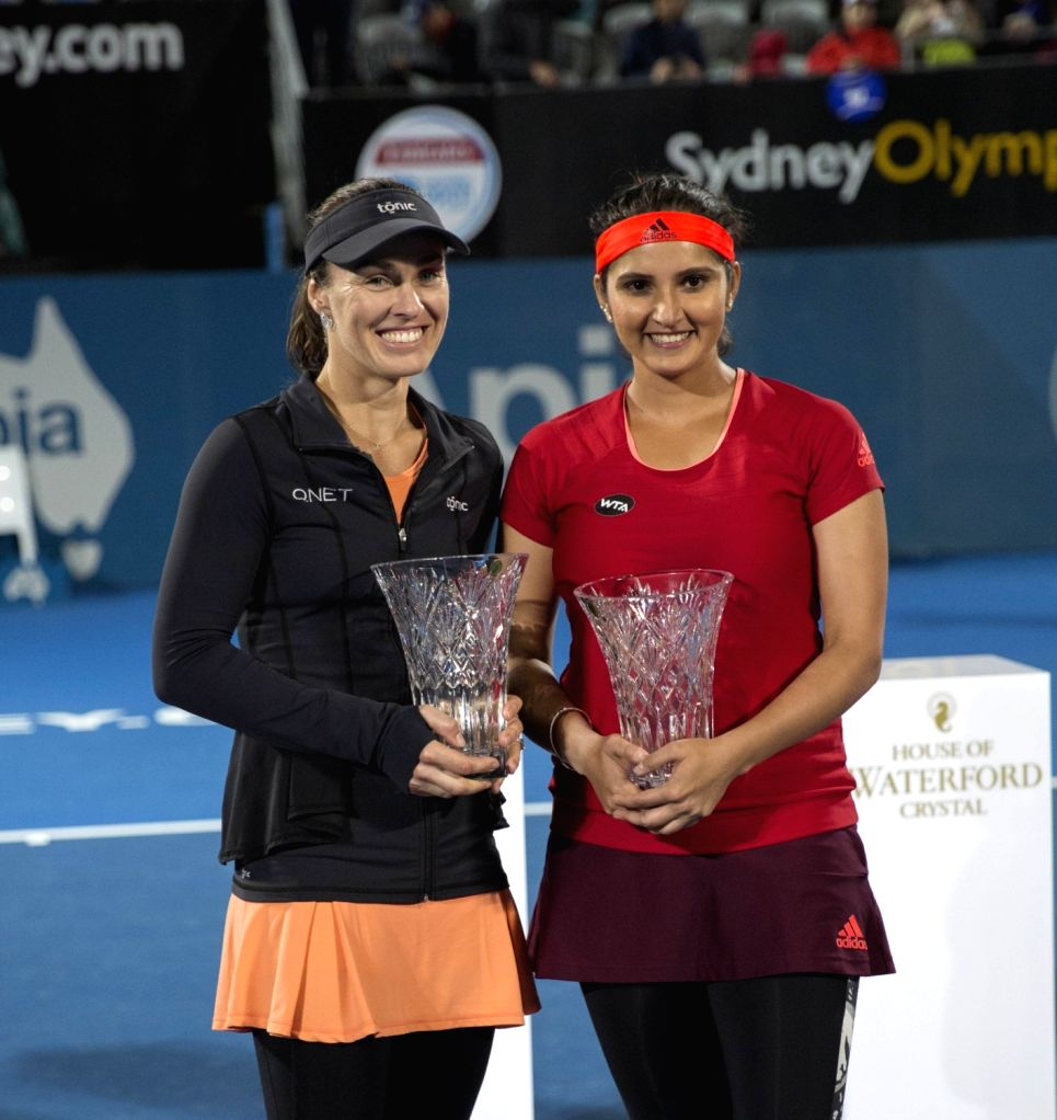 Martina Hingis (L) of Switzerland and Sania Mirza of India pose for photograph during the awarding ceremony of the women's doubles final against Caroline Garcia and ... - Martina Hingis and Sania Mirza
