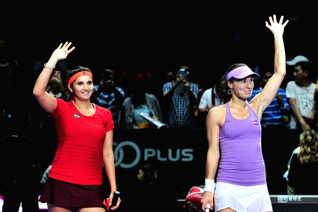 Martina Hingis (R) of Switzerland and Sania Mirza of India wave to the crowds after the women's doubles semi-final match against Chan Hao-Ching and Chan ... - Martina Hingis and Sania Mirza