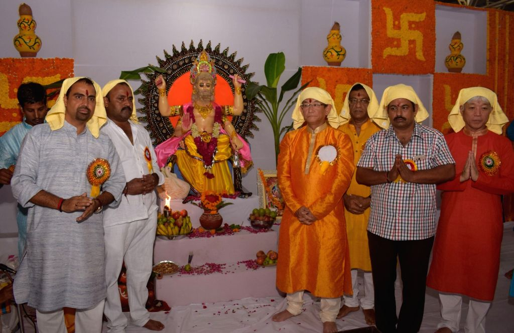 Maruti Suzuki India Limited Managing Director and CEO Kenichi Ayukawa performs Vishwakarma Puja with workers at Sector 18 plant in Gurugram on Sept 17, 2017.