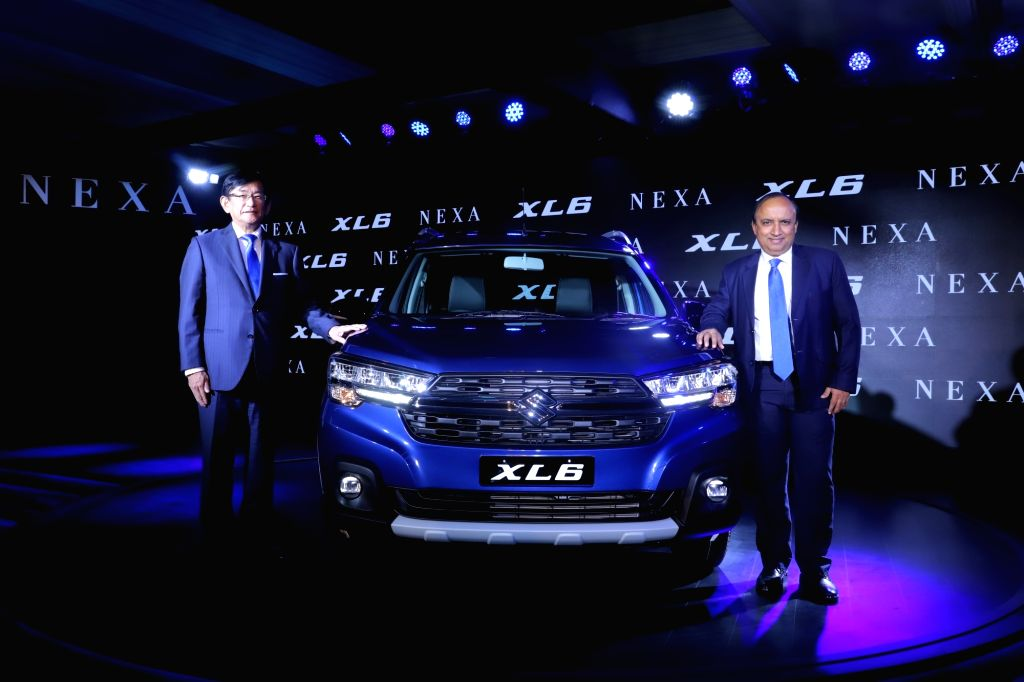 Maruti Suzuki India MD and CEO Kenichi Ayukawa and Executive Director (Marketing and Sales) Shashank Srivastava at the launch of Maruti Suzuki NEXA's new premium MPV XL6, in New Delhi on ...