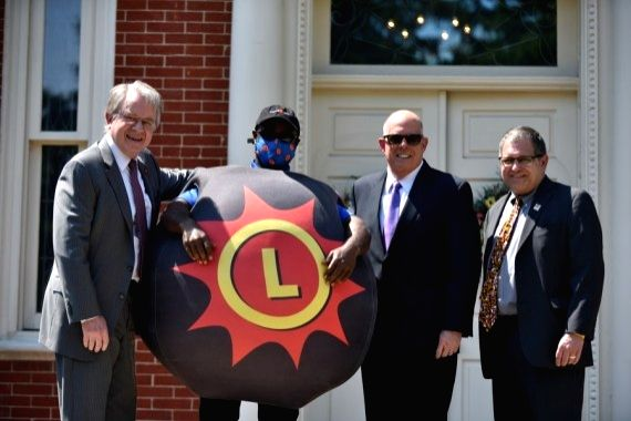 Maryland Governor Larry Hogan (Right 2nd) on May 20, 2021 launched a 2-million-dollar lottery that will hand out dozens of 40,000-dollar cash prizes to state residents who have received coronavirus ...
