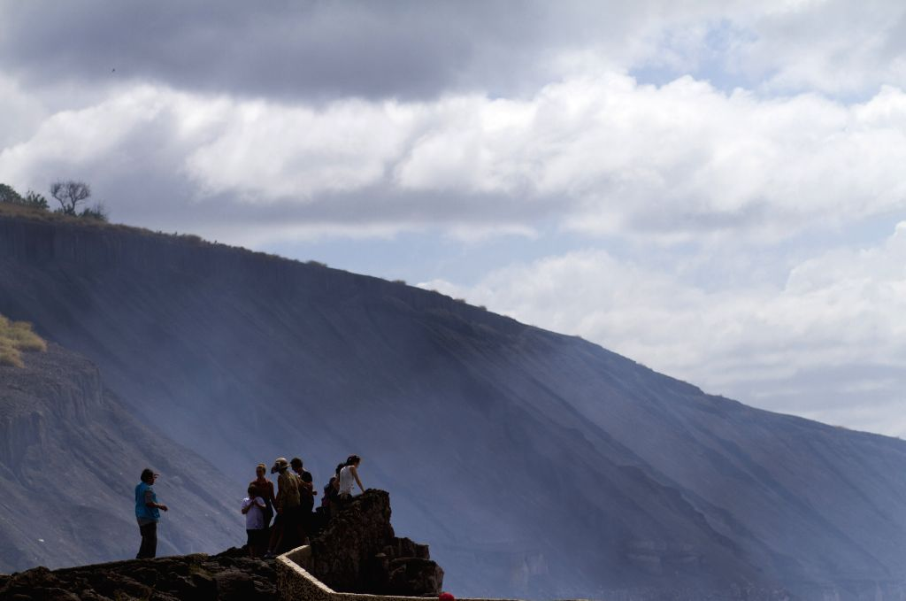 People are seen in front of the crater Santiago in the Masaya Volcano National Park, in the Masaya department, Nicaragua, on Dec. 30, 2014. The Masaya Volcano ...