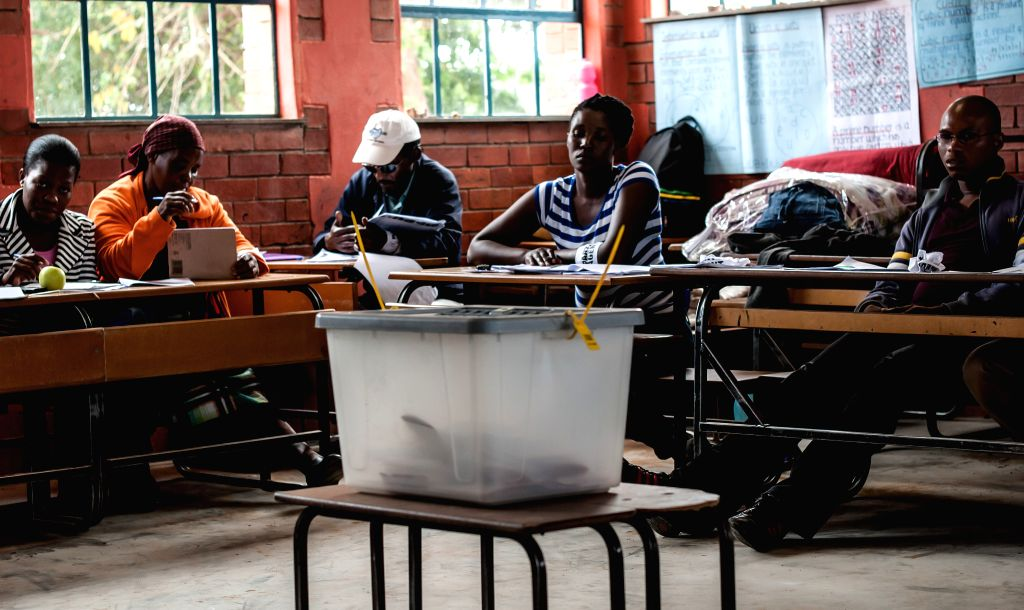 People fill their ballots at a voting center in Maseru, capital of Lesotho, on Feb. 28, 2015. Voters in Lesotho went to the polls on Saturday for an early election ...