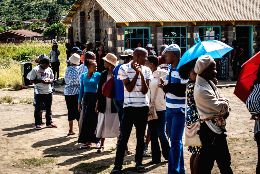 People stand in line for voting at a voting centre in Maseru, capital of Lesotho, on Feb. 28, 2015.  Voters in Lesotho went to the polls on Saturday for an early ...