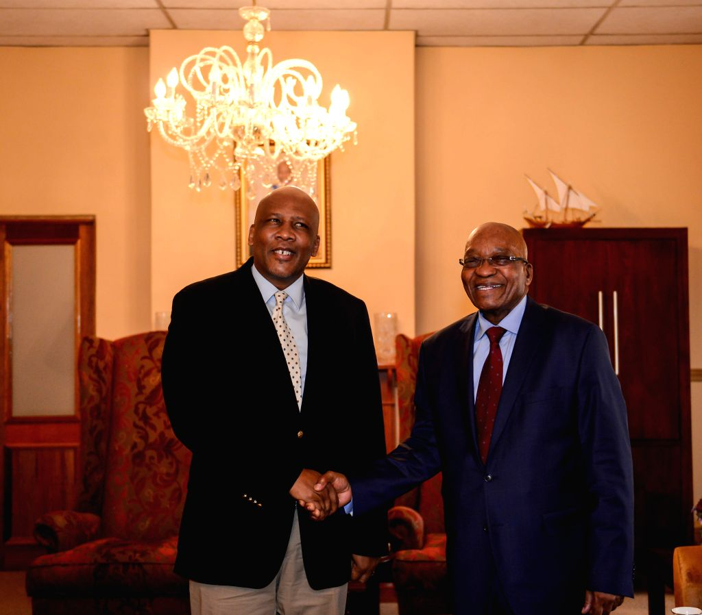 Lesotho's King Letsie III (L) shakes hands with visiting South African President Jacob Zuma in Maseru, Lesotho, on Sept. 9, 2014. South African President Jacob Zuma .