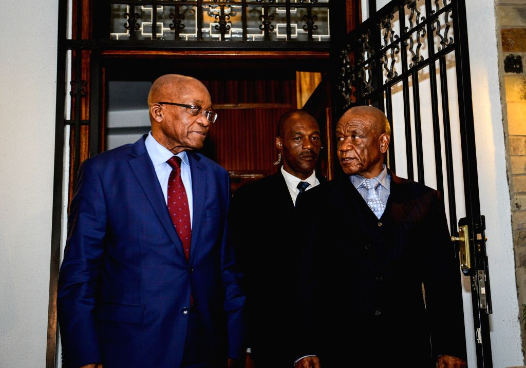 Lesotho's Prime Minister Thomas Thabane (R) walks out of the State House with visiting South African President Jacob Zuma after a meeting in Maseru, Lesotho, on ... - Thomas Thabane