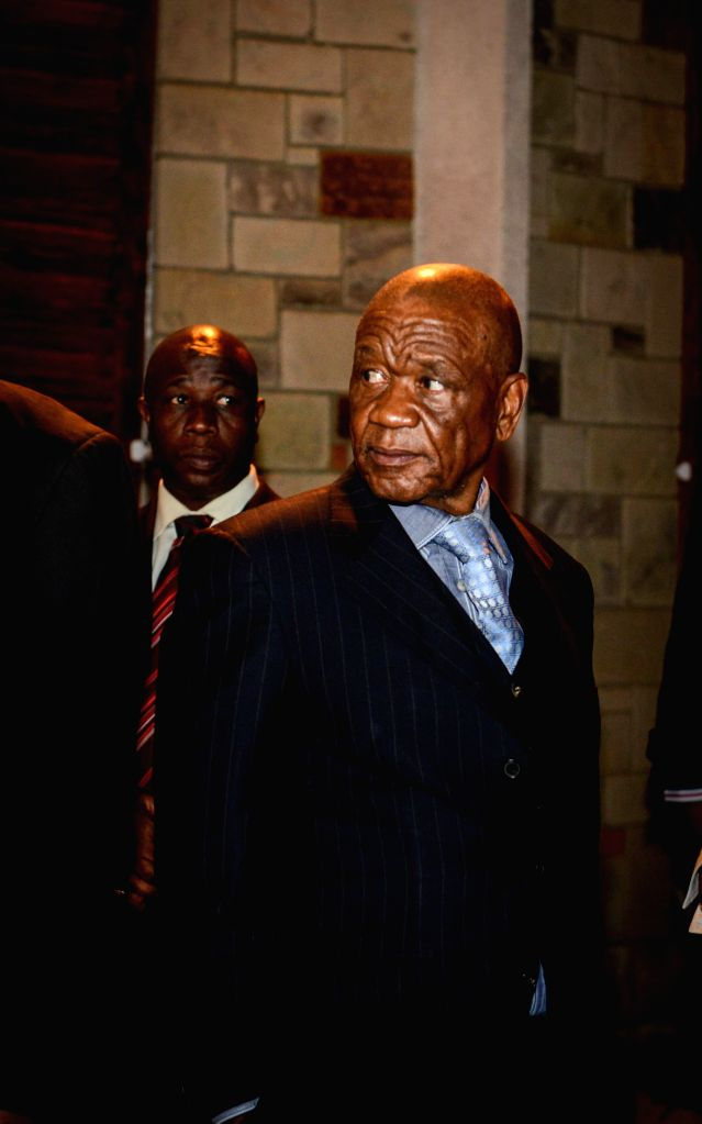 Lesotho's Prime Minister Thomas Thabane walks out of the State Housein after a meeting with visiting South African President Jacob Zuma (not in the picture) in ... - Thomas Thabane