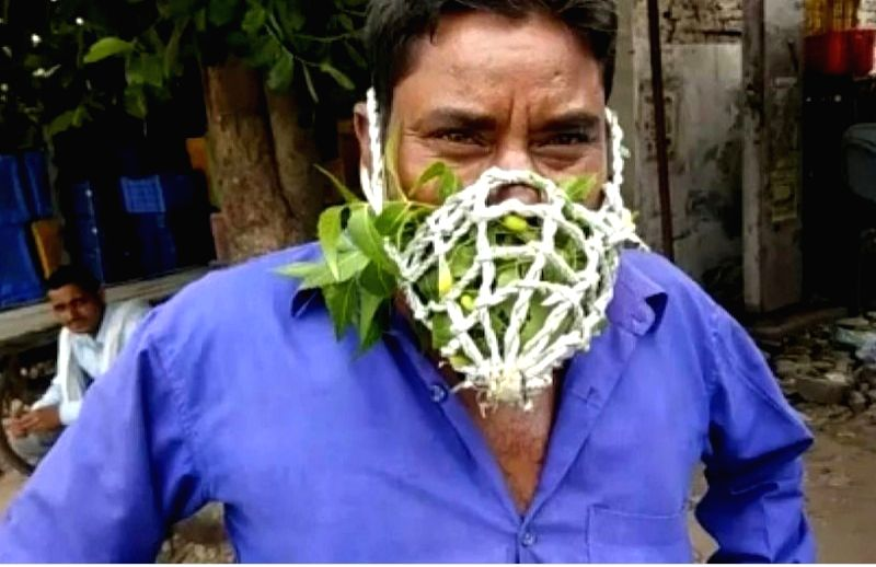 Mask filled with neem leaves.