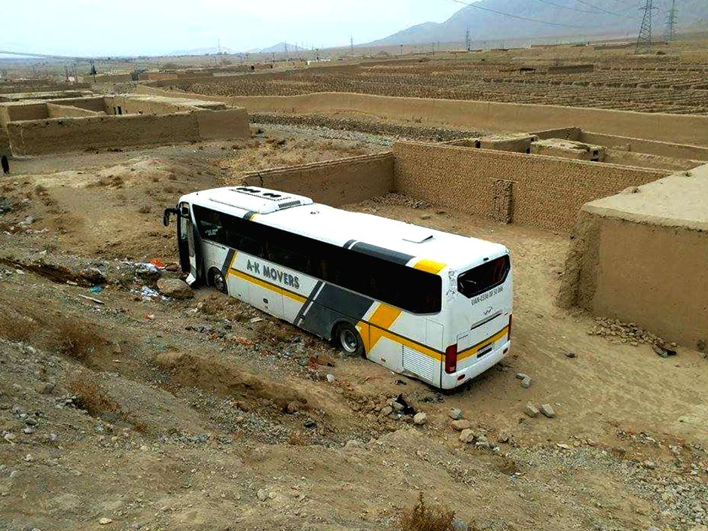 MASTUNG, Feb. 11, 2018 - Photo taken with mobile phone shows a damaged passenger bus near southwest Pakistan's Mastung, on Feb. 11, 2018. At least five passengers were killed and 15 others injured ...
