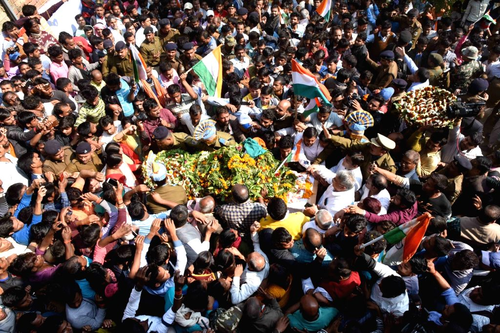 Masurhai: Last rites of martyr Sanjay Kumar Sinha, one of the 49 CRPF personnel killed in 14 Feb militant attacks, underway in Masurhai, Patna district, Bihar on Feb 16, 2019. (Photo: IANS) - Sanjay Kumar Sinha