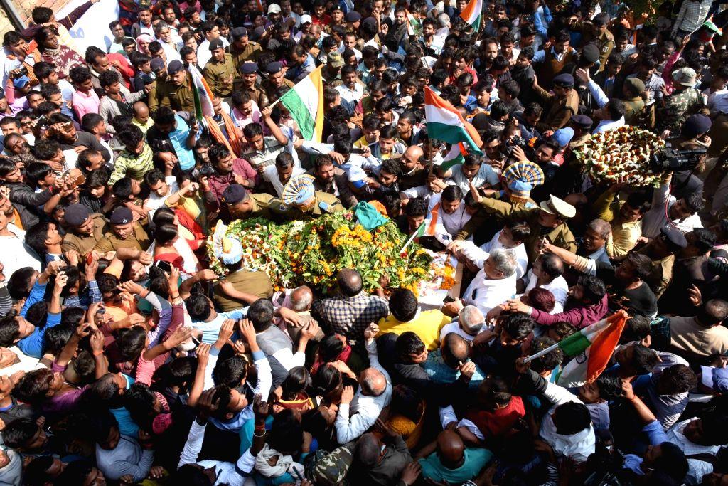 Masurhai: Last rites of martyr Sanjay Kumar Sinha, one of the 49 CRPF personnel killed in 14 Feb militant attacks, underway in Masurhai, Patna district, Bihar on Feb 16, 2019. (Photo: IANS) - Sanjay Kumar Sinha