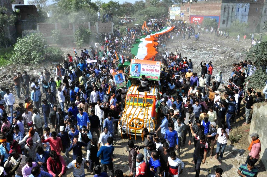 Masurhai: People in large numbers participate in the last rites of martyr Sanjay Kumar Sinha, one of the 49 CRPF personnel killed in 14 Feb Pulwama  militant attacks in Masurhai, Patna district, Bihar on Feb 16, 2019. (Photo: IANS) - Sanjay Kumar Sinha