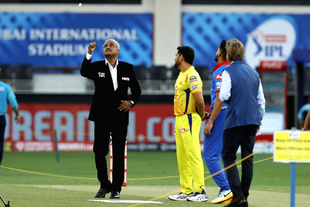 Match commissioner flipping the toss coin during match 7 of season 13, Dream 11 Indian Premier League (IPL) between Chennai Super Kings and Delhi Capitals held at the Dubai International Cricket Stadium, Dubai in the United Arab Emirates on the 25th