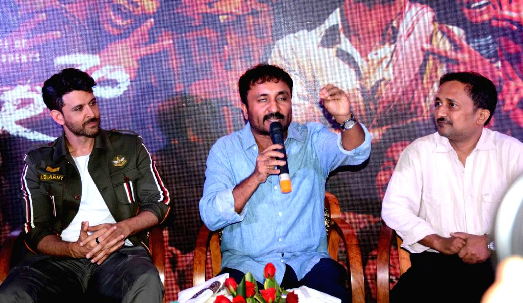 """Mathematician Anand Kumar accompanied by actor Hrithik Roshan, addresses during the promotions of the film """"Super 30"""" in Patna on July 16, 2019. - Hrithik Roshan and Anand Kumar"""
