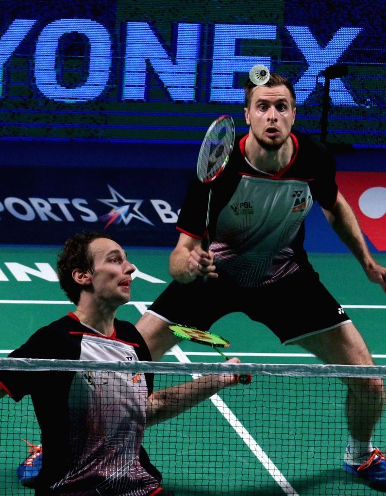 Mathias Boe and Vladimir Ivanov of Mumbai Rockets in action against Delhi Acers' Tan Boon Heong and Koo Keat Kien during a Premier Badminton League match in New Delhi, on Jan 17, 2016. ...