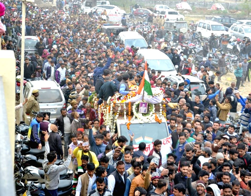 Mathura: A huge crowd gathered as the body of CRPF soldier Kaushal Kumar Rawat who was martyred in the Pulwama terror attack, reached his native village Kahari, near Mathura on Feb. 16, 2019. (Photo: IANS) - Kaushal Kumar Rawat